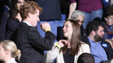 Durham, NH: Congressman Joe Kennedy high fives an audience member. Photo by Vaishnavee Sharma/ BU News Service.