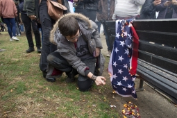 A protester burns the American flag at the Disrupt J20 protest on Friday,Jan. 20, 2017. Photo by Vaishnavee Sharma/BU News Service.