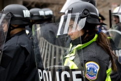An officer stares into the crowd of protesters, some of whom threw rocks and other items at the police, during the Disrupt J20 protest. Photo by Vaishnavee Sharma/BU News Service.