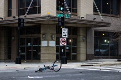 Remnants of rocks thrown by protesters, and an abandoned bicycle lies in the streets at the intersection of 12th and K street in D.C. Photo by Vaishnavee Sharma/BU News Service.