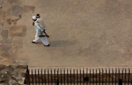 An Indian Muslim carries a disable person on his back to Feroz Shah Kotla Jami Mosque for Eid al-Fitr prayers in New Delhi, India, Monday, June 26, 2017. Eid al-Fitr marks the end of the Muslims' holy fasting month of Ramadan. (AP Photo/Vaishnavee Sharma)