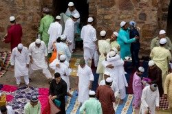 Indian Muslims hug and greet each other after offering Eid al-Fitr prayers at the 14th century Feroz Shah Kotla Jami Mosque in New Delhi, India, Monday, June 26, 2017. Eid al-Fitr marks the end of the Muslims' holy fasting month of Ramadan. (AP Photo/Vaishnavee Sharma)