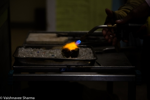 A student uses a blowtorch under instructor supervision to smoothen out his paperweight at Diablo Glass School in Roxbury, MA, on October 30, 2017.